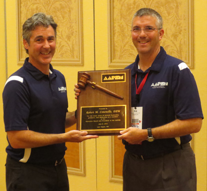 AAPSM Immediate Past President Rob Conenello, DPM (r) receives his presidential plaque recognizing his years of service on the AAPSM Board from incoming President Paul Langer, DPM.