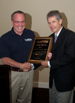 David Davidson, DPM (l) presents 2010 Robert Barnes Distinguished Service Award to Richard Bouche', DPM during the AAPSM Annual Membership Meeting in Seattle, Washington