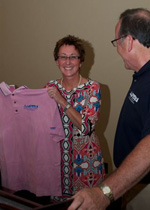"Incoming AAPSM President Karen Langone, DPM accepts the new AAPSM ""pink apparel"" from outgoing President David Davidson, DPM"