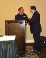 David Davidson, DPM presents the 2010 Richard Schuster Biomechanics Award to Stephen Pribut, DPM during the AAPSM Annual Membership Meeting in Seattle, Washington