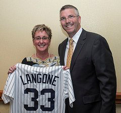 Past President Karen Langone, DPM (l) receives a commemorative #33 New York Yankee jersey from AAPSM incoming President Rob Conenello, DPM recognizing her as the 33rd president of the AAPSM.