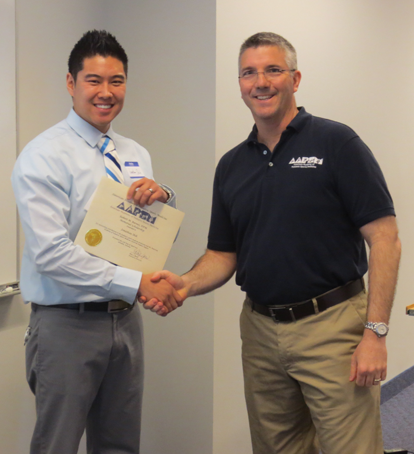 Jonathan Shih (left) a 2nd year student at The Arizona School of Podiatric Medicine (AZPOD) is presented the Robert M. Barnes, DPM Memorial Scholarship by current AAPSM President Rob Conenello, DPM (right) at the AAPSM Day of Sports Medicine held April 13 at AZPOD. The award is presented to an AAPSM Student Chapter Member who has made significant contributions to podiatric sports medicine. Jon is the 24th recipient of this Award.