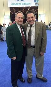AAPSM President Alex Kor, DPM congratulates David Craig on his induction into the NATA Hall of Fame